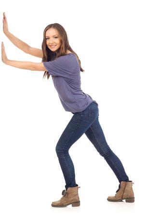 Photo pour Smiling girl pushing - image libre de droit