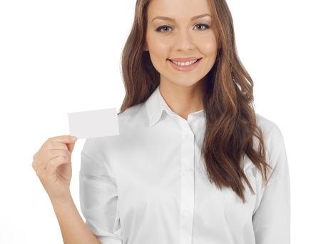 Photo pour Woman holding a business card - image libre de droit