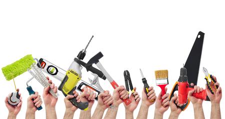 Photo pour Hands holding tools - image libre de droit