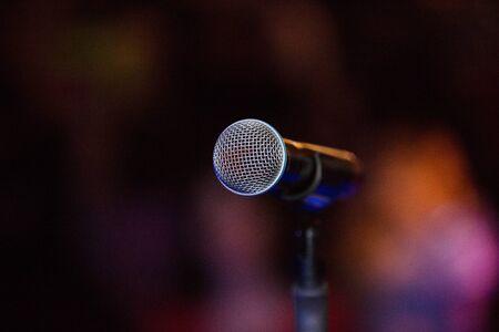 Photo pour Vocal microphone on a stage at night, copy space - image libre de droit