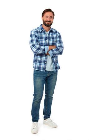 Photo pour Young man smiling on white background - image libre de droit