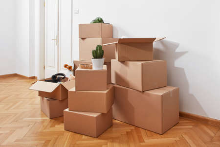 Photo for Cardboard boxes in a room - Royalty Free Image
