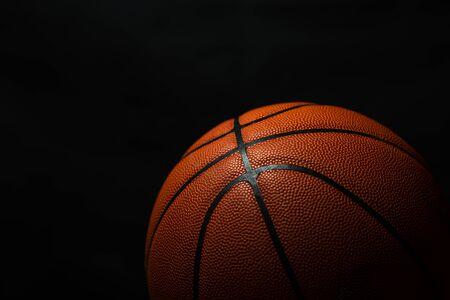 Foto de Basketball under the light with a black background - Imagen libre de derechos