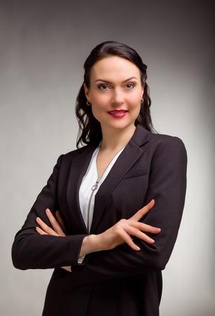 Photo pour Portrait of wonderful business woman on gray background - image libre de droit