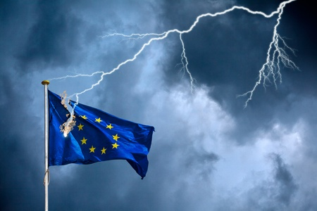 The European Union suffers from a crisis, visualised by the European flag struck by lightning during a storm