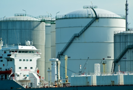 Oil tanker in front of oil station exchanging cargo