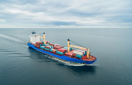 Photo pour Aerial view of container vessel sailing in open sea - image libre de droit