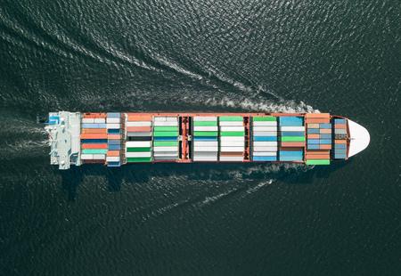 Foto de Container ship sailing in sea - Imagen libre de derechos