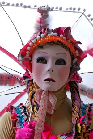 a female puppet in the gardens