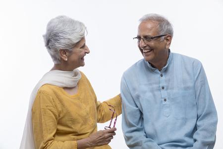 Photo pour Senior couple looking at each other and talking - image libre de droit