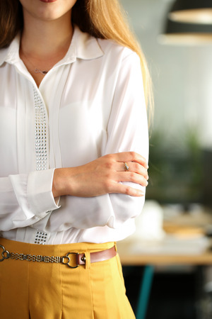 Hands of female businesswoman in blouse crossed on chest in office. Serious business, stock or foreign exchange market, job offer, excellent education, advisor, certified public accountant concept
