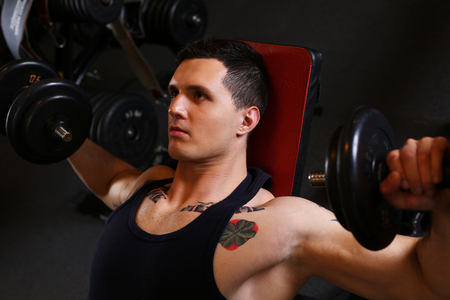 Sporty young man work out chest. Modern athletic trend, health care, heavy work, calorie burn diet, slim and power people, hobby and leisure activity, action wear shop, gain and pain concept