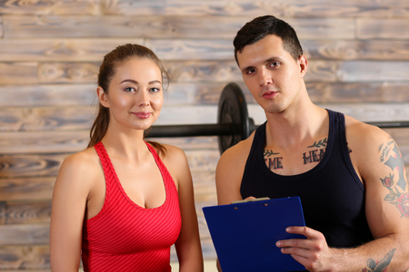 Sporty young smiling couple work out together. Modern athletic family, health care, heavy work, calorie burn diet, slim and power people, hobby and leisure activity trend, action wear shop concept