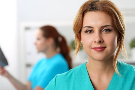 Photo pour Close-up of beautiful confident medical worker in special uniform. Modern medicine and innovation. Healthcare and check-up concept. Nurse on background - image libre de droit