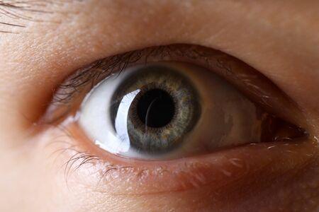 Photo pour Male gray green colored right eye in low light technique close-up - image libre de droit