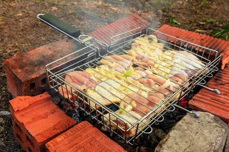 Chicken being roasted over charcoal