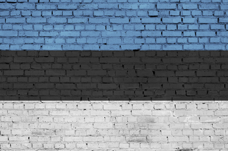 Estonia flag is painted onto an old brick wall