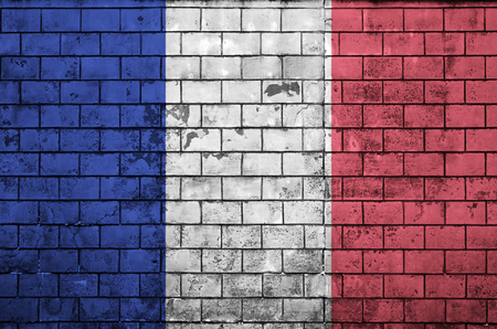 France flag is painted onto an old brick wall