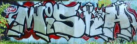 Street art. Abstract background image of a full completed graffiti painting in chrome and red colors.