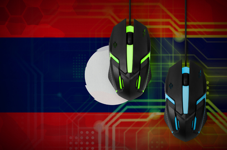 Laos flag  and two modern computer mice with backlight. The concept of online cooperative games. Cyber sport team