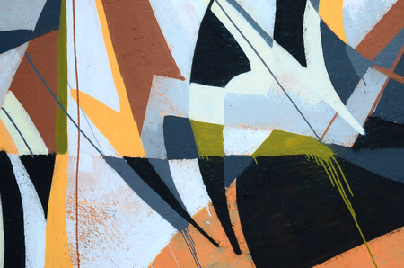 Fragment of colored street art graffiti paintings with contours and shading close up. Background texture of youth contemporary art culture. Grey and orange colors