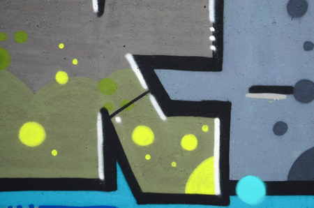 Fragment of colored street art graffiti paintings with contours and shading close up. Background texture of youth contemporary art culture. Camouflage khaki colors