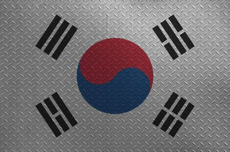 South Korea flag depicted in paint colors on old brushed metal plate or wall close up. Textured banner on rough background