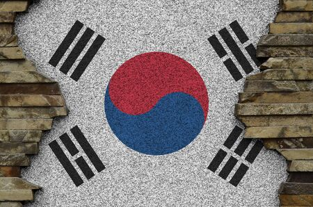 South Korea flag depicted in paint colors on old stone wall close up. Textured banner on rock wall background