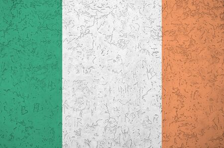 Photo for Ireland flag depicted in bright paint colors on old relief plastering wall close up. Textured banner on rough background - Royalty Free Image