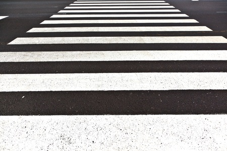 signs for pedestrian crossing are painted on the street