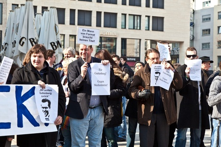 FRANKFURT, GERMANY - March 5: People demonstrate for return of Karl Theodor zu Guttenberg into politics on March 05,2010 in Frankfurt, Germany. Guttenberg demissed his job due to faked dissertation.
