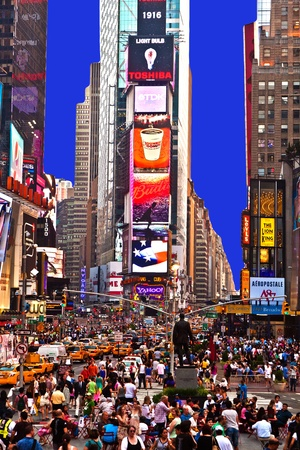 view to crowded times square in New York in the evening on July 2010
