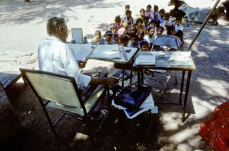 INDIA, AGRA - AUGUST 01: teacher teaches children in the outdoor classroom on August 01,1994 in Agra, India. India  expands literacy to approximately two thirds of the population