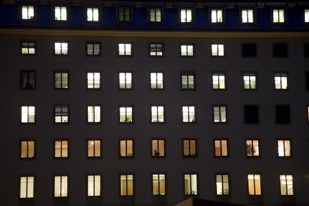 windows of a business house with light by night giving a structured impression, vienna