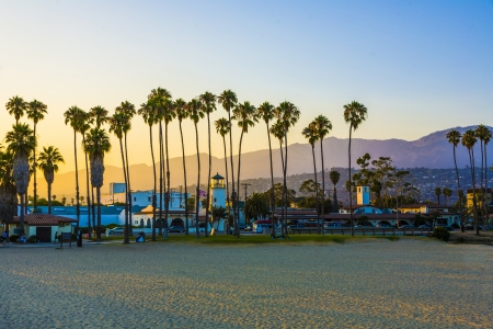 scenic promenade with lighthouse and palms in Santa Barbara in sunset