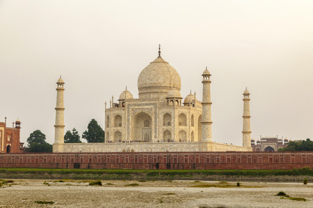 taj mahal from yamuna river in sunset