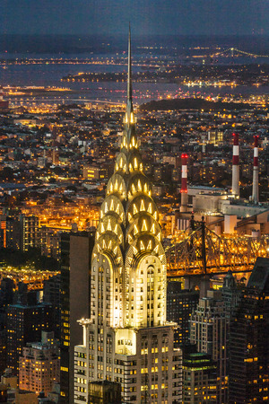 Photo pour NEW YORK, USA - JULY 10, 2010: Facade of the Chrysler Building in the night  in New York, USA. It was the world's tallest building before it was surpassed by the Empire State Building in 1931. - image libre de droit