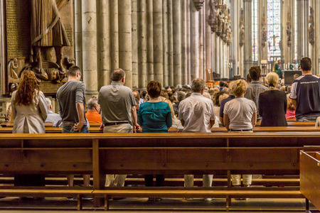COLOGNE, GERMANY- SEP 7, 2014: church service held in the cathedral in Cologne, Germany. The dome is Germanys most visited landmark visited by 20.000 people a day.