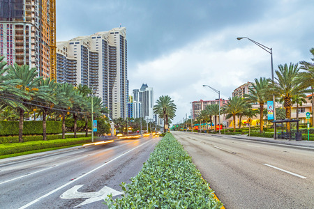 SUNNY ISLES BEACH, USA - AUG 17, 2014: early morning streetview in Sunny Isles Beach, USA. It is a growing resort area and developers have invested heavily in construction of high-rise  condominiums.