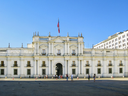 SANTIAGO, CHILE - JAN 25, 2015: people visit the Palacio de la Moneda in Santiago, Chile. The palace was opened in 1805 as a colonial mint, but later became the presidential palace.