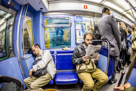 PARIS , FRANCE- JUNE 10, 2015: Tourists and locals on a subway train Line 8 in Paris, France. More than 30 million people visit Paris annually.
