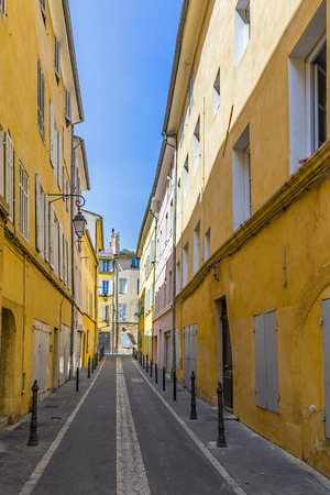 narrow street with old typical houses in Aix en Provence
