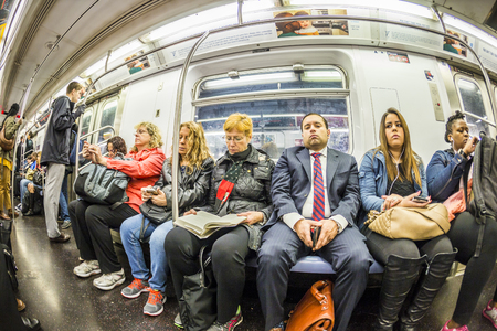 NEW YORK, USA - OCT 21 2015: People travel in the Metro in  New York. With 1.75 billion annual ridership, NYC Subway is the 7th busiest metro system in the world.