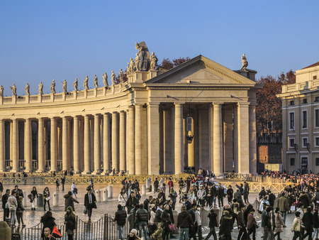 VATICAN CITY,VATICAN - DEC 23, 2015 : Tourists on foot Saint Peter's Square in Vatican.It is the smallest internationally recognized independent state in the world, Jan 6, 2015 in, Vatican.