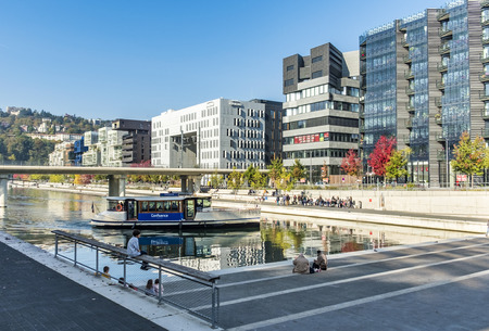 LYON, FRANCE - NOV 1, 2016: famous Confluence District with people in Lyon, France with river. The modern architecture is famous and won lot of prices.