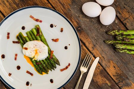 Photo for Food photography of a poached egg with asparagus, and crispy bacon - Royalty Free Image