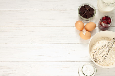 Photo pour Ingredients for baking a cake, top view - image libre de droit
