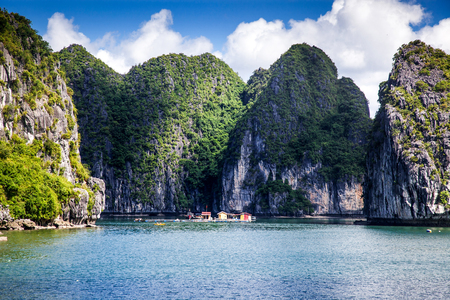 cruising among beautiful limestone rocks and secluded beaches in Ha Long bay,  Vietnam