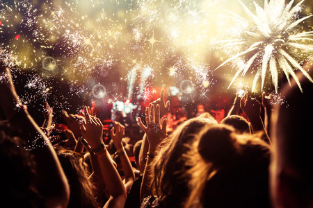 Foto de new Year concept - cheering crowd and fireworks - Imagen libre de derechos