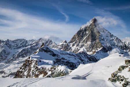 Photo pour view of Matterhorn peak against blue sky Swiss Alps - image libre de droit